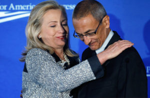"WASHINGTON, DC - OCTOBER 12: U.S. Secretary of State Hillary Clinton (L) embraces Center for American Progress President and CEO John Podesta before addressing the centers' ""American Idea: A More Perfect Union"" conference at the Decatur House October 12, 2011 in Washington, DC. Clinton briefly addressed a plot the U.S. government said it foiled to assassinate the Saudi ambassador to the United States by elements of the Iranian government. (Photo by Chip Somodevilla/Getty Images)"